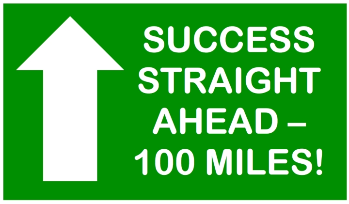 100 miles sign